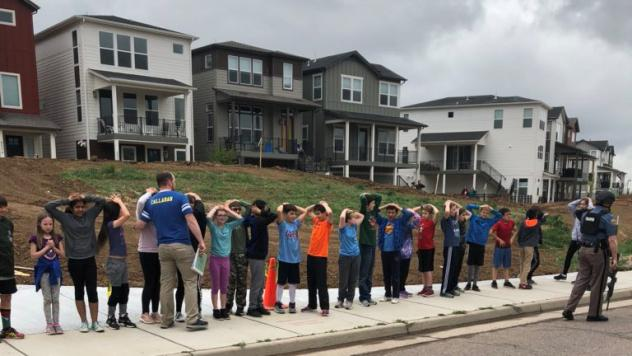 Students line up near STEM School Highlands Ranch during a shooting at the Colorado school that left one dead and eight injured on Tuesday.