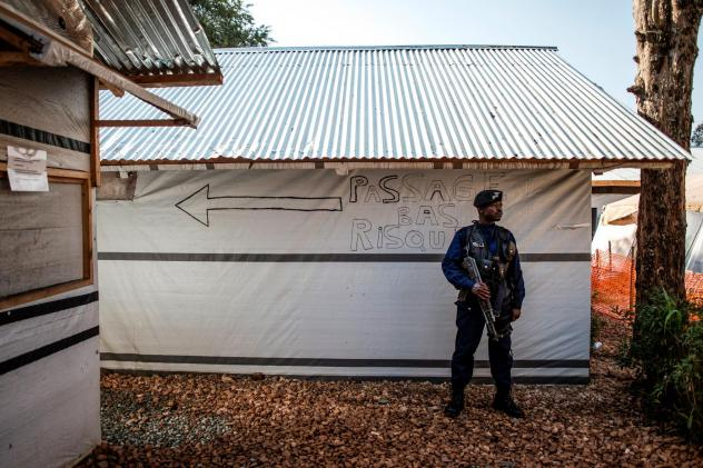A police officer stands guard inside an Ebola treatment center in Butembo. Rebels attacked the facility on March 9, killing one officer and injuring another.