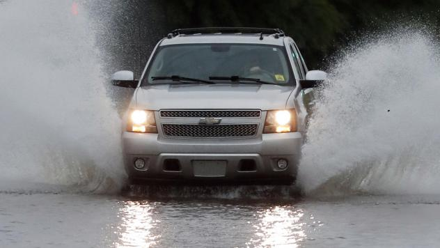 A vehicle drives through floodwaters in downtown Jackson, Miss., on Thursday, as strong winds, tornado warnings and substantial rains added to the flash flooding throughout Mississippi.