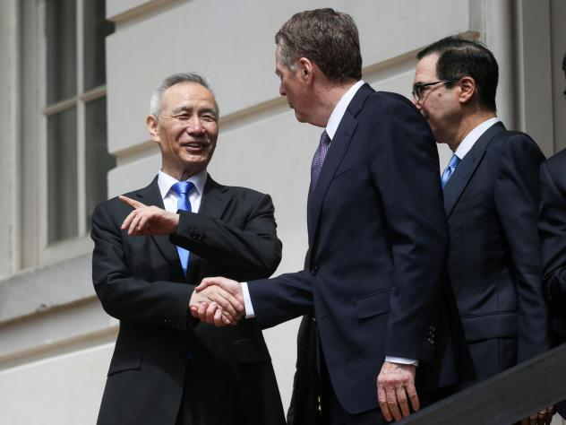 Chinese Vice Premier Liu He talks with U.S. Trade Representative Robert Lighthizer and Treasury Secretary Steven Mnuchin as they depart a round of trade talks in Washington on Friday.