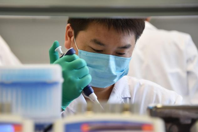 "A technician works in a lab at GeseDNA Technology in Beijing. To counter China, the U.S. plans to impose new export restrictions on ""emerging and foundational technology"" that researchers say could affect the way they share genetic materials with interna"