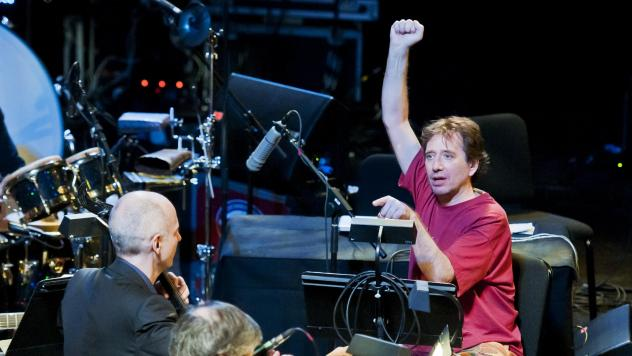 John Zorn, in red, conducts music from 'Book of Angels' with the Bar Kokhba Sextet (feat. Marc Ribot on guitar, Mark Feldman on violin, Erik Friedlander on cello, and Cyro Baptista on percussion) during his 'Masada Marathon' at Lincoln Center in New York