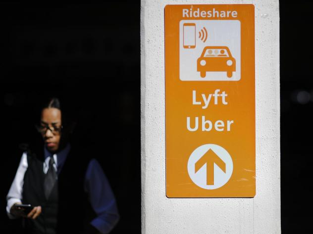 A sign directs Lyft and Uber riders to a designated pickup location at Hartsfield-Jackson Atlanta International Airport in Atlanta.