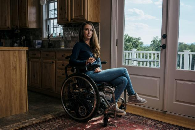 Dani Izzie at her home in rural Virginia. More than a decade ago, she slipped in the bathroom and suffered a spinal cord injury that has left her unable to walk. She works as a social media manager for Spinergy, a company that makes high-performance whee