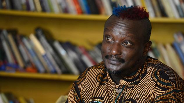 Kenyan author Binyavanga Wainaina, seen here during a January 2014 interview in Nairobi, has died at the age of 48. A founder of the Nairobi-based literary network <em>Kwani?</em>, Wainaina had come out as gay in a country where homosexuality was illegal