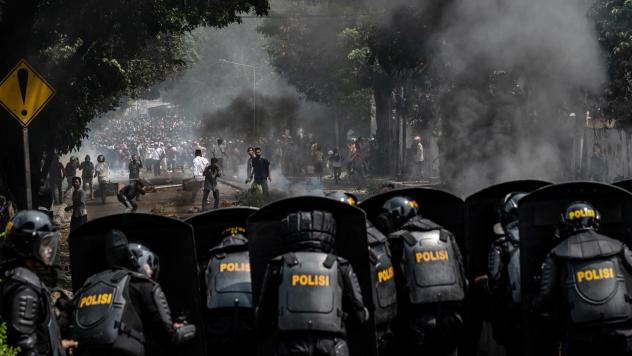 Protesters clash with Indonesian riot police after the official government election results were announced in Jakarta, Indonesia. Officials say six people have died and more than 200 were injured during mass rallies in central Jakarta.