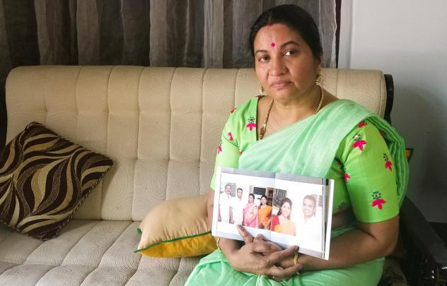 Bindu Sampath, 52, shows photos of her daughter Nimisha Sampath, now 29, who left India three years ago, after converting to Islam. She and her husband, a fellow Muslim convert, are wanted by Indian authorities for allegedly joining ISIS. They're believe