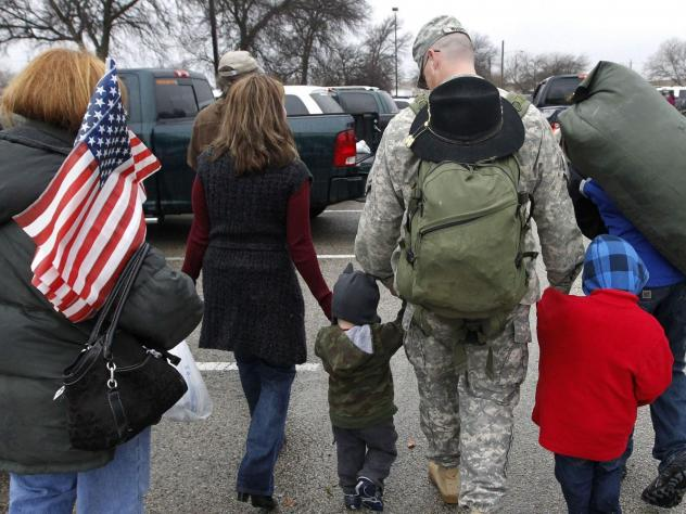 In this Dec. 24, 2011 file photo, a soldier walks with his family following a ceremony at Fort Hood, Texas, for soldiers from the U.S. Army 1st Cavalry 3rd Brigade, who returned home from deployment in Iraq.