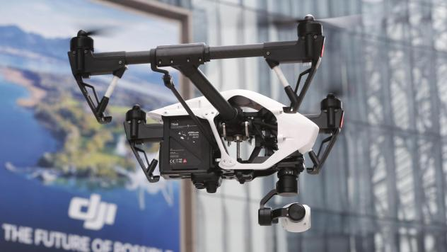 A DJI Technology drone flies during a demonstration in Shenzhen, China, in 2014. DJI sells the majority of Chinese-made drones bought in the United States.