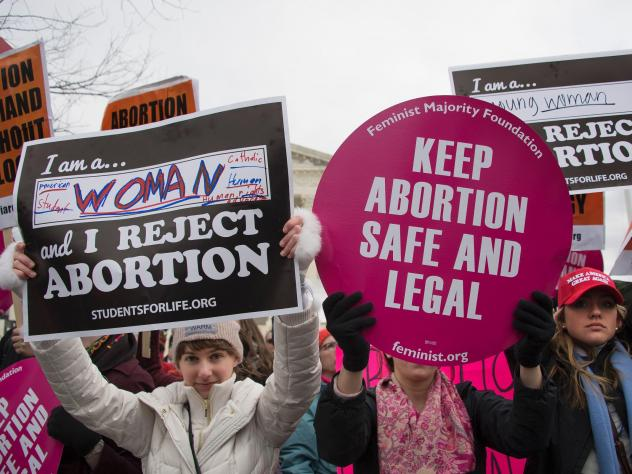 Protesters demonstrate in front of the US Supreme Court during the March For Life in Washington, DC, January 27, 2017.