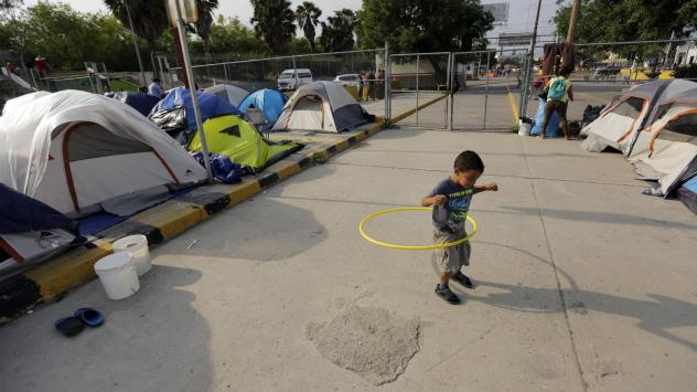 William Linares, a 5-year-old from Honduras, plays in an encampment where he is living near the international bridge in Matamoros, Mexico, on April 30. The boy is traveling with his mother, Suanny Gomez, and seeking asylum in the United States.