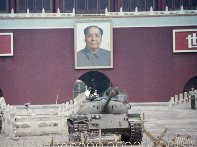 A People's Liberation Army tank sits below a portrait of Mao Zedong at the Gate of Heavenly Peace in Beijing on June 11, 1989, one week after the crackdown on protesters at Tiananmen Square.