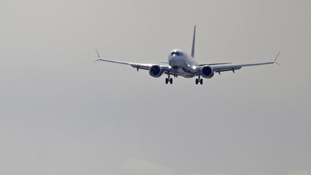 A Boeing 737 Max operated by Air Canada comes in for a landing on March 27 at Boeing Field in Seattle. In addition to problems detected with the 737 Max, the FAA says there is a new issue with some 737s: They may have faulty parts on their wings.