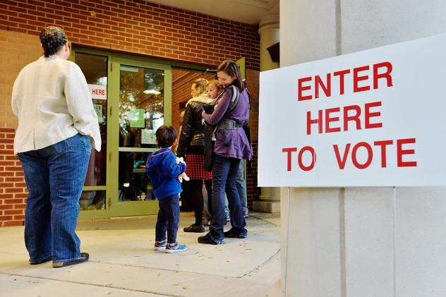 A voting line trails outside of a precinct on Election Day 2016 in Durham, N.C. The county's polling places were plagued by malfunctioning equipment to check in voters that day, and it was later revealed that the vendor behind that equipment had been tar