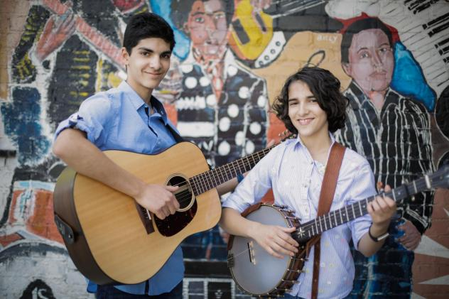 <em>Origins</em>, the debut album by 14- and 11-year-old siblings Giri (left) and Uma Peters, is a set of traditional folk and blues songs that puts the duo's intention to spotlight the black musical traditions that shaped and spread the tunes.