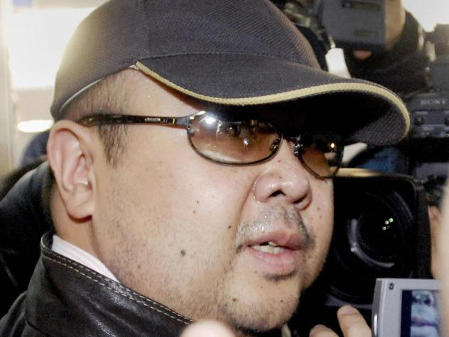 A man believed to be Kim Jong-Nam is surrounded by journalists upon his arrival at Beijing's capital airport, in February 2007.