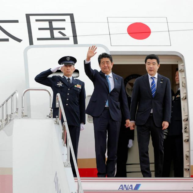 Japan's Prime Minister Shinzo Abe waves to well-wishers on his departure from Tokyo's Haneda Airport on Wednesday for a two-day visit to Iran.