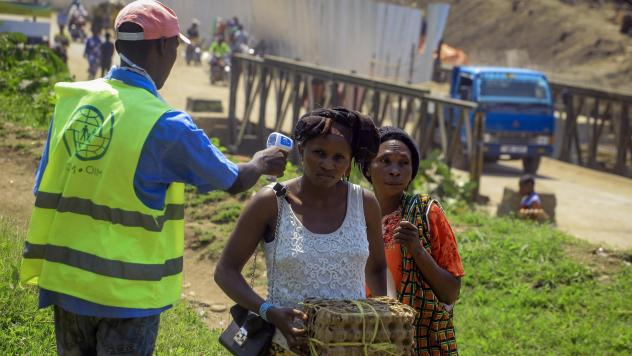 Uganda has reported its first death from Ebola. Here, a health worker takes a woman's temperature at a border crossing between Uganda and Democratic Republic of the Congo, part of an effort to screen for Ebola and prevent its spread.