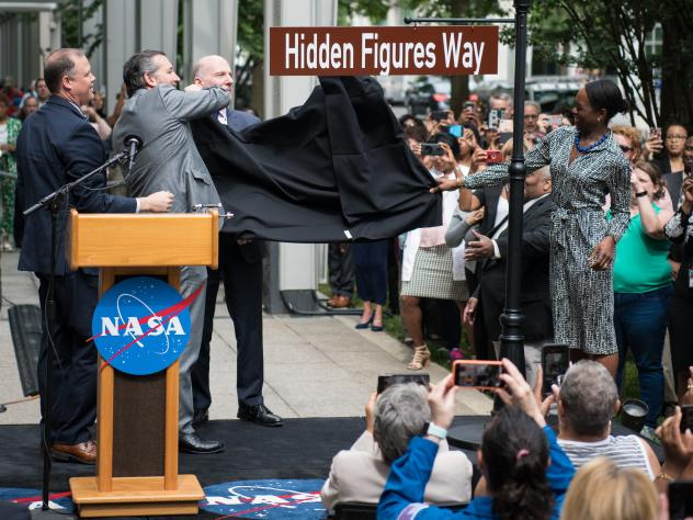 NASA Administrator Jim Bridenstine (from left), Sen. Ted Cruz, D.C. Council Chairman Phil Mendelson and Margot Lee Shetterly, author of the book <em>Hidden Figures,</em> unveil the Hidden Figures Way street sign at a dedication ceremony on Wednesday in W