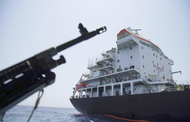 The U.S. Navy says a limpet mine put a hole in this Panama-flagged, Japanese-owned tanker anchored off Fujairah, United Arab Emirates. The limpet mines used to attack the tanker near the Strait of Hormuz resemble mines displayed by Iran, a Navy explosive