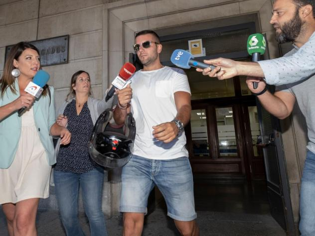 "Journalists surround Ángel Boza, one of five members of the ""Wolf Pack,"" on Friday. Spain's Supreme Court found the five men guilty of gang rape, overturning previous convictions on the lesser offense of sexual abuse in a case that shook the country."