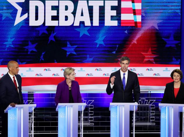 Former Texas Rep. Beto O'Rourke (third from left) speaks as Sens. Cory Booker, Elizabeth Warren and Amy Klobuchar look on during the first night of the Democratic presidential debate, Wednesday in Miami.
