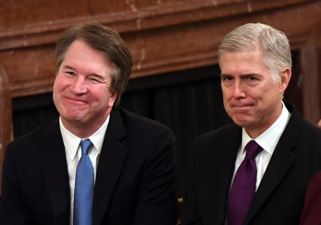 Supreme Court Justices Brett Kavanaugh (left) and Neil Gorsuch attend the Presidential Medal of Freedom ceremony at the White House last year.