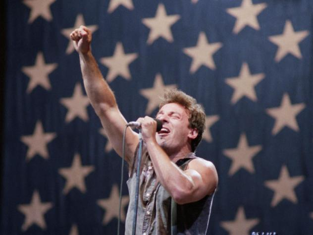 "Bruce Springsteen belts out his hit song ""Born in the USA"" before a sellout crowd in 1985."