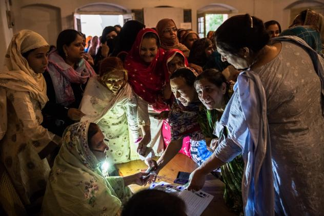 Pakistani women jostle to receive their ballot papers prior to casting their ballot at a polling station on May 11, 2013 in Lahore. A study in <em>The Lancet</em> provides evidence that free and fair elections are associated with a lower burden of chroni