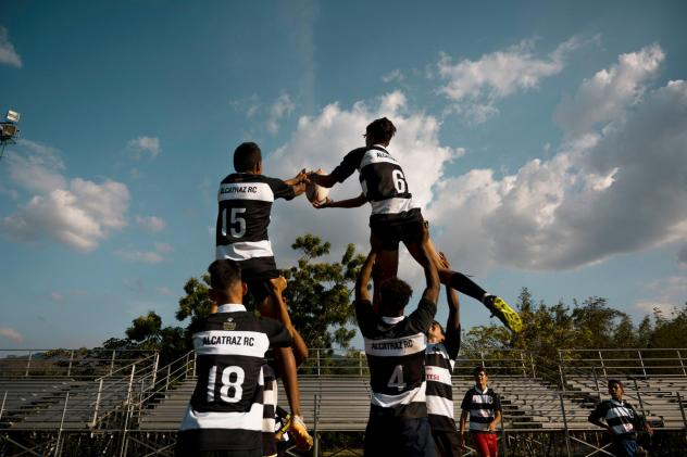 Young men practice rugby at Hacienda Santa Teresa, an estate belonging to a Venezuelan rum company. The estate serves as a practice field for neighboring communities of Aragua state, using rugby to help at-risk youths stay away from criminal life and vio