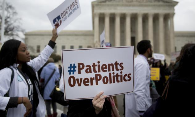Demonstrators from Doctors for America marched in support of the Affordable Care Act outside the U.S. Supreme Court in March 2015. Now, another case aims to undo the federal health law: <em>Texas v. United States</em> could land in front of the Supreme C