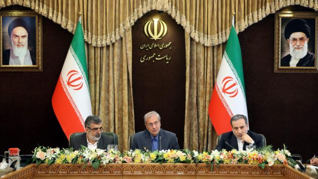 From left: Iran's Atomic Energy Organization spokesman Behrouz Kamalvandi, government spokesman Ali Rabiei and Deputy Foreign Minister Abbas Araghchi give a joint press conference at the presidential headquarters in the capital Tehran on Sunday. Iran is