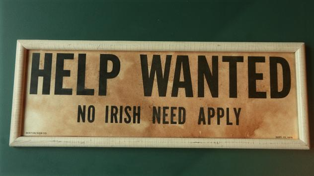 """""""Help Wanted/No Irish Need Apply"""" sign photographed in 1998 at O'Riley Hibernian Pub in Lawrence, Mass."""