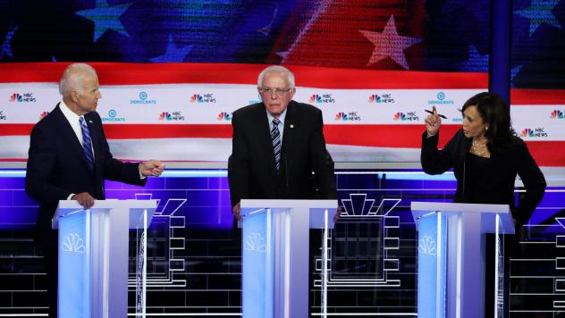 Sen. Bernie Sanders is in the middle as former Vice President Joe Biden and Sen. Kamala Harris face off in the June 27 debate in Miami. Harris and Biden will again share center stage in the July 31 debate.