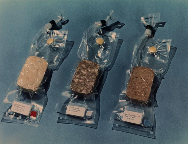 Some of the space food that was scheduled to be carried on the Apollo 11 lunar landing mission included (from left to right): chicken and vegetables, beef hash, and beef and gravy.