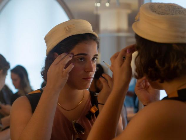 A customer tests an eyebrow pencil in the mirror at the New York City flagship store for the beauty startup Glossier. It's one of the latest companies to become a unicorn, with a market value of $1 billion as of March.