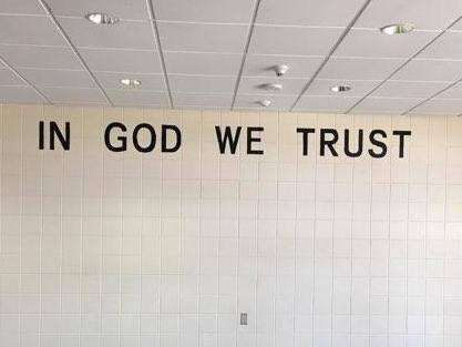 "An ""In God We Trust"" sign is seen at a middle school in Rapid City, South Dakota. Staff began installing the national motto in the district's 23 schools in May."