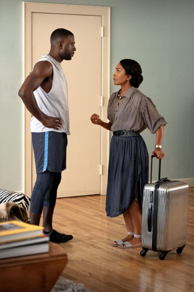 Carol (Angela Bassett) shows up unannounced in New York City for a surprise visit with her adult son, Matt (Sinqua Walls) in the new Netflix film <em>Otherhood.</em>