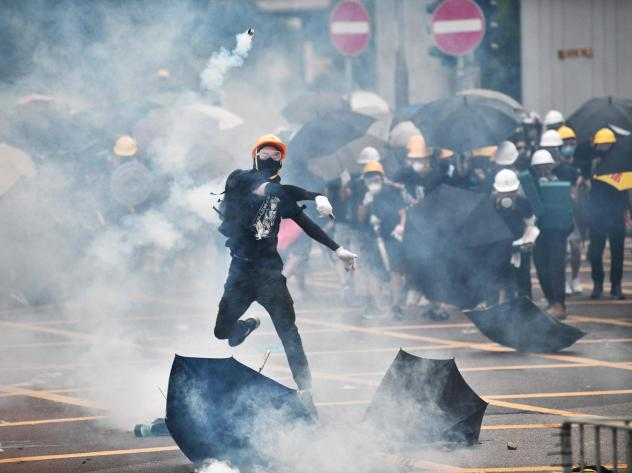 Faceoffs between protesters and police broke out during a demonstration in the district of Yuen Long in Hong Kong on Saturday.