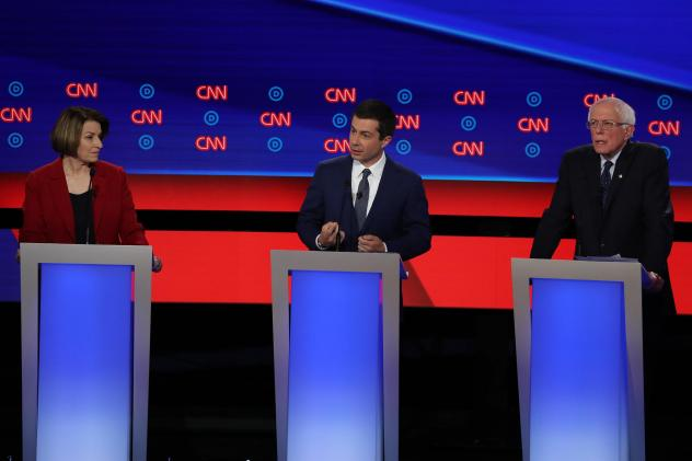 Democratic presidential candidate South Bend, Ind., Mayor Pete Buttigieg (center), speaks while Sens. Amy Klobuchar and Bernie Sanders listen during the Democratic presidential debate in Detroit on Tuesday. All three agree on the need to ban assault-styl
