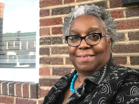 Wanda<strong> </strong>Onafuwa says a house next door to her in Baltimore fell into disrepair after Bank of America foreclosed on the property.
