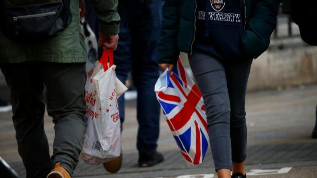 Major retailers report sharp drops in sales of single-use plastic bags, after a fee was instituted in 2015.