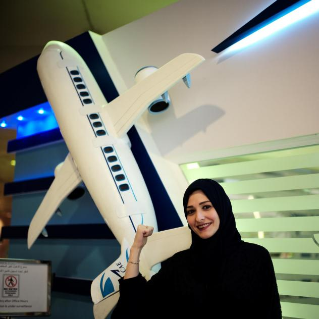 Dalia Yashar, one of the first Saudi students who registered to become a commercial pilot, stands in front of the registration centre, CAE Oxford ATC, at King Fahd International Airport in Dammam, Saudi Arabia, last July.