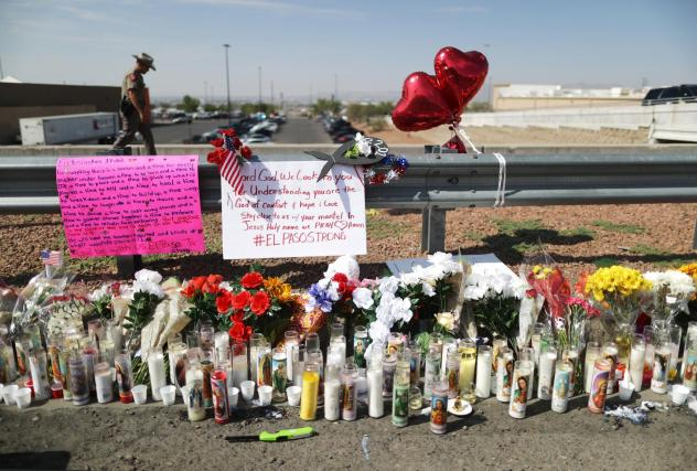 """A makeshift memorial is set up outside Walmart, near the scene of Saturday's mass shooting in El Paso, Texas. Lawmakers in some states have passed what are known as """"red flag"""" laws to prevent such shootings."""