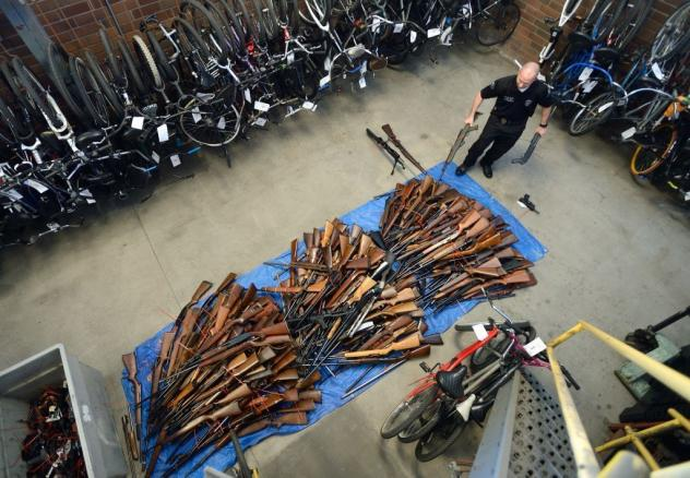 Guns collected in an effort to buy back firearms in Anaheim, Calif., in 2016. The police department obtained 676 guns and gave out $100 gift cards in exchange. The U.S. rate of deaths from gun violence, at 4.43 deaths per 100,000 people, it is four times