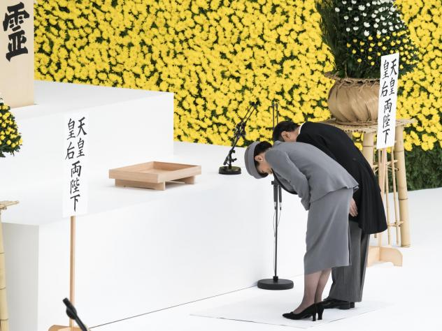 Japan's Emperor Naruhito and Empress Masako bow during a memorial service marking the 74th anniversary of Japan's surrender in World War II at the Nippon Budokan Hall on Thursday in Tokyo.