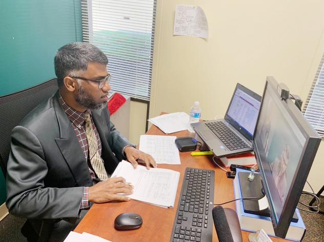 Dr. Sarfraz Khan, chief medical officer at Meridian Health Services in Indiana, connects with patients over the internet.