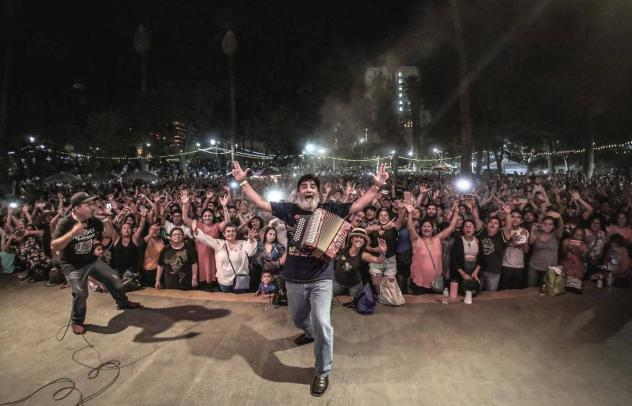 An audience in los Angeleles share its love for Celso Piña.