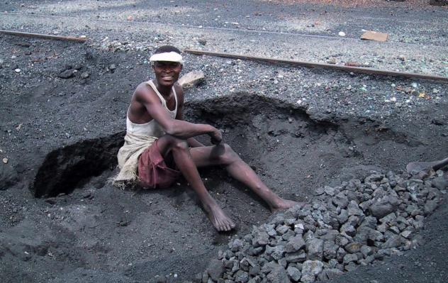 Looking for scraps of lead to sell, young people in the town of Kabwe, Zambia, dig through the toxic tailings left behind from 100 years of mining.