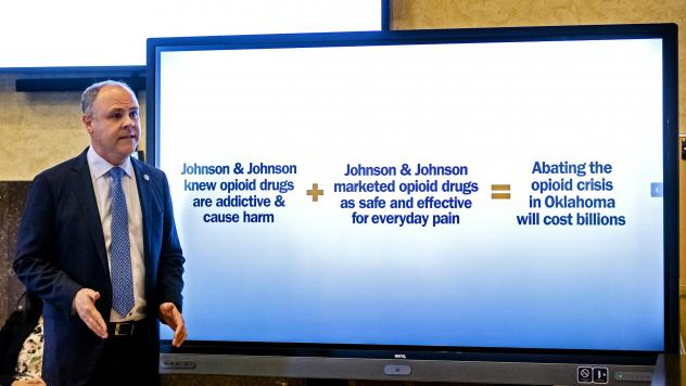 State's attorney Brad Beckworth lays out one of his closing arguments in Oklahoma's case against drugmaker Johnson & Johnson at the Cleveland County Courthouse in Norman, Okla. in July. The judge in the case ruled Monday that J&J must pay $572 million to